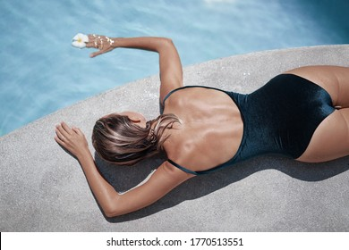 Beauty and body care. Young woman relaxing in outdoor spa swimming pool.