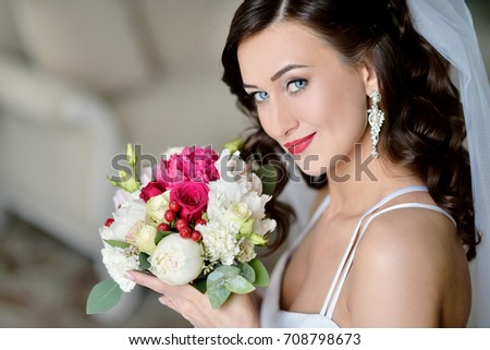 d2edf44d466 Beauty bride in bridal gown with bouquet and lace veil indoors. Beautiful  model girl in
