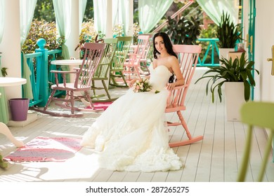 Beauty bride in wedding dress in romantic cute interior