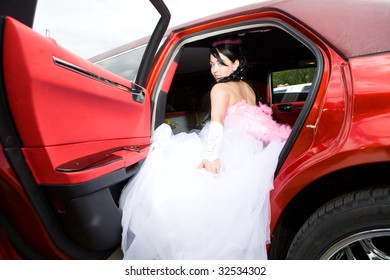 beauty bride woman with limousine outdoor