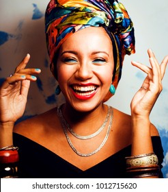beauty bright african american woman with creative make up, shaw