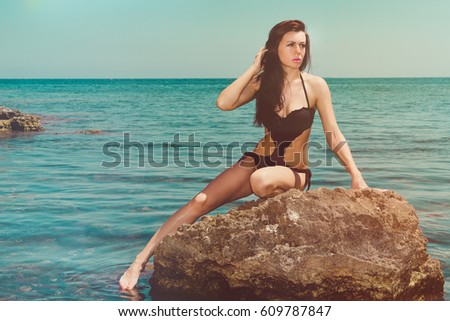 Beautiful Brunette With Big Blue Eyes Like The Sea Doing