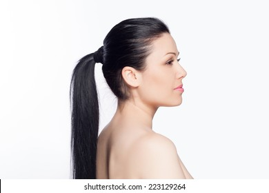 Beauty Brunette Fashion Model Girl with Long Healthy Straight Brown Hair. Ponytail Hairstyle Concept. Beautiful Woman with brown long Healthy Smooth Straight hair