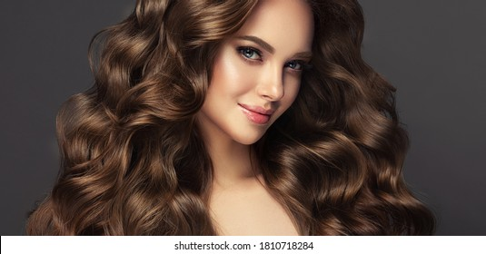 Beauty brunette girl with long  and   shiny wavy black hair .  Beautiful   woman model with curly hairstyle . - Shutterstock ID 1810718284