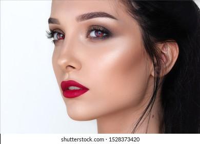 a beauty brunette mystery woman portrait, red vampire eyes