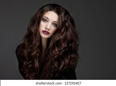 Beauty brunette   on dark background
