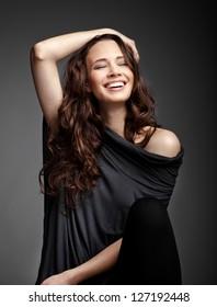 Beauty brunette smiling  on dark background