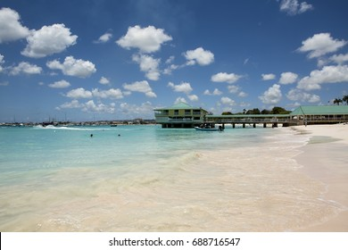 The Beauty of Carlisle Bay. Carlisle Bay is just south of Bridgetown, the capital of Barbados. On the east coast, the waters are from the Caribbean Sea and are calm, peaceful and a tropical blue.