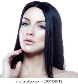 Beauty caucasian model girl with nude makeup, natural lips and perfect fresh skin hold hand near face. Skincare facial treatment concept