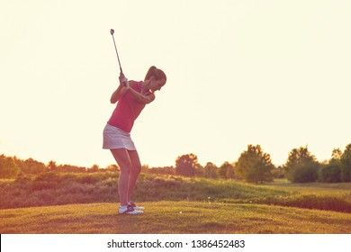 Beauty Cheerful Young Adult Girl Playing Golf at Sunset Beautiful Golf Course