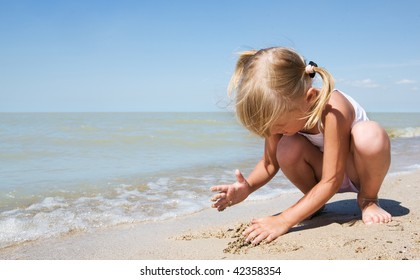 beauty child at sea under blue sky