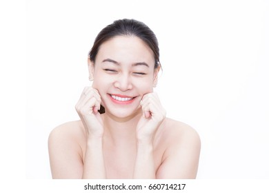 Beauty, clean and clear face of beautiful Asian woman looking at camera while using her hand touching her cheek on her face (isolated on white background)