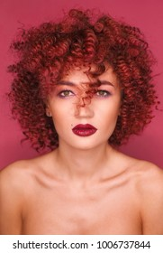 Beauty close up portrait of woman with curly hair and red lips
