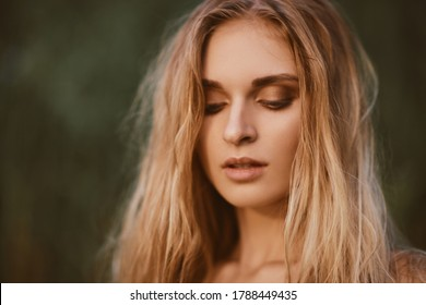 Beauty close up portrait of young beautiful european woman with wet white blond hair and clean skin. Relaxing beauty fashion concept