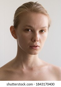 Beauty Close-up face portrait of young woman without make-up. Natural image without retouching , shallow depth of field.