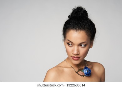 Beauty closeup portrait of beautiful mixed race caucasian - african american woman wearing chocker looking to side, isolated on gray background