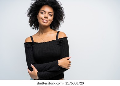 Beauty closeup portrait of young african american girl with afro. Girl looking at camera. Ideal skin.