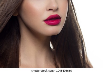 Beauty closeup of women full red lips with shiny skin and long hair. Facial skin care in a spa salon or cosmetology and a fashionable natural lip gloss or lipstick. Day makeup