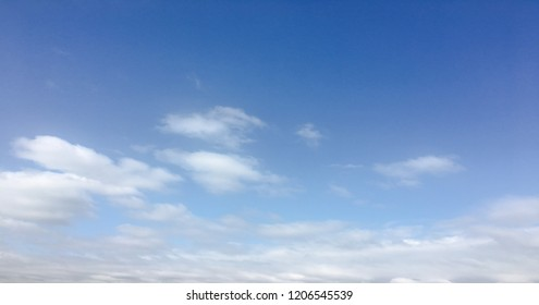 Beauty cloud against a blue sky background. Sky slouds. Blue sky with cloudy weather, nature cloud. White clouds, blue sky and sun.
