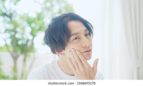 Beauty concept of asian man. Men's cosmetics.