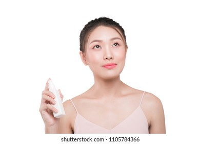 Beauty concept. Asian pretty woman with perfect skin  applying spray water treatment on face