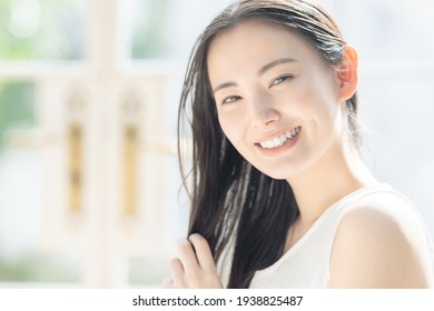 Beauty concept of attractive asian woman. Skin care. Hair care.