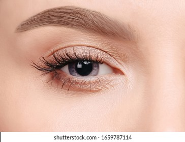 Beauty concept Close up photo template Young blue-eyed woman with nude eye makeup