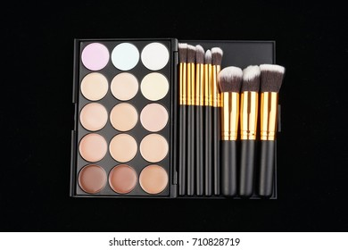 Beauty concept. Cosmetic accessories on black background viewed from top or flat lay.
