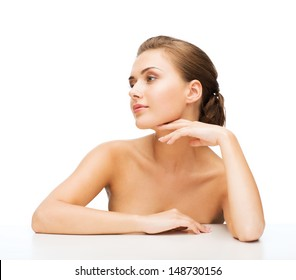 beauty concept - face and hands of beautiful woman with clean perfect skin