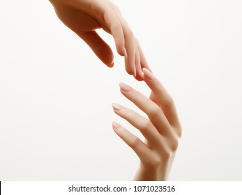 Beauty concept. Hand skin care. Closeup of beautiful woman hands with light manicure on nails. Cream for hands and treatment