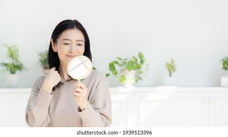 Beauty concept of middle aged asian woman. Skin care. Hair care.