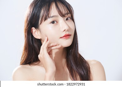 Beauty concept portrait of young Asian woman with soft highlights