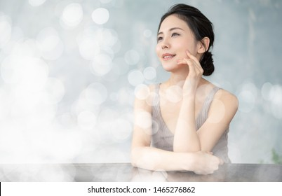 Beauty concept of a young asian woman. Skin care. Body care. Cosmetics.