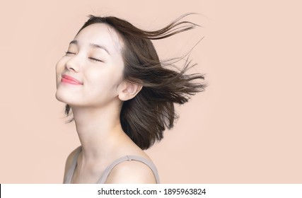 Beauty concept of a young asian woman. Hair care. Cosmetics.