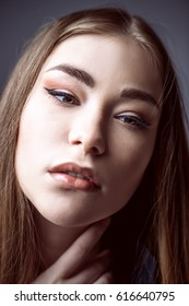 Beauty concept. Young woman with long straight hair. Hairstyle, healthy hair. Cosmetics and make-up.