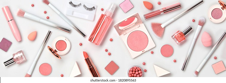 Beauty cosmetic makeup background. Fashion woman make up product, brushes, lipstick, nail polish collection. Creative pink concept. Cosmetology make-up accessories banner, top view.