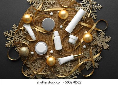 Beauty cosmetic products with Christmas decoration on golden beaded mat
