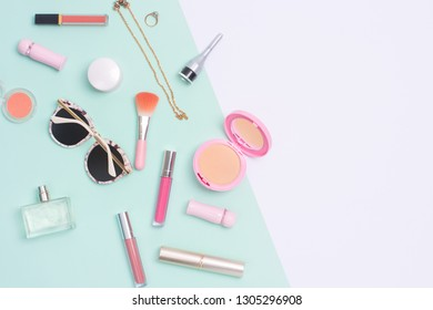 Beauty and cosmetic products flat lay image on split color background.