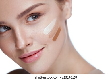 Beauty Cosmetics. Attractive Young Woman With Clean Soft Skin And Fresh Professional Makeup. Closeup Beautiful Sexy Girl With Liquid Tonal Cream, Foundation Stripes On Face. Skin Care. High Resolution