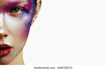 Beauty, cosmetics and makeup. Magic eyes look with bright creative make up. Macro shot of beautiful woman's face with perfect art makeup with glitter. Closeup. Body art