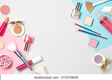 Beauty cosmetics makeup product flying. Woman make up, brushes lipstick blush falling in air. Creative fashion concept. Cosmetology make-up design color border fly, levitation.