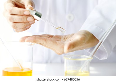 Beauty cosmetics sciences, Formulating and mixing skincare with herbal essence, Scientist testing a new organic beauty products on hand.