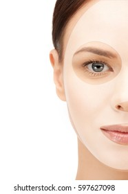 beauty, cosmetology, hydration, people and rejuvenation concept - close up of beautiful young woman half face with collagen facial mask over white background