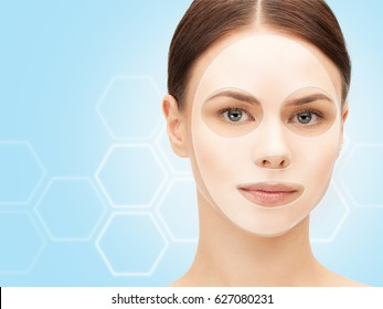 beauty, cosmetology, hydration, people and rejuvenation concept - close up of beautiful young woman with collagen facial mask over blue background