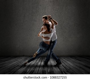 beauty couple dancing social danse ( kizomba or bachata or semba or taraxia) , on grey background