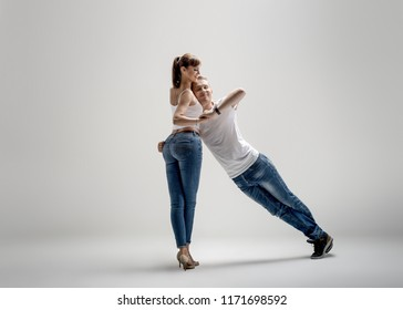 beauty couple dancing social danse ( kizomba or bachata or semba or taraxia) , on white-grey background