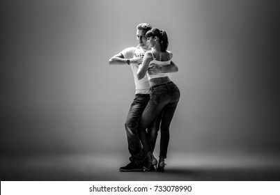 beauty couple dancing social danse ( kizomba or bachata or semba or taraxia) , black-and-white photo