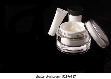 Beauty Cream Containers on Black Background with room for Text