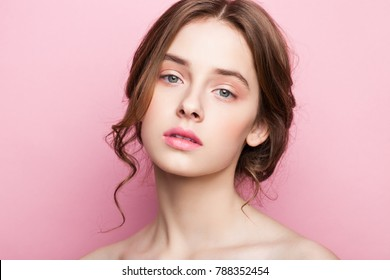 Beauty cute fashion model with natural make up on pink background