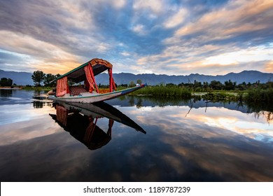 The beauty of Dal lake and the beautiful Shikaras during sunrise and sunset is the most charming thing in Kashmir